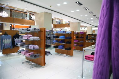 Clothes on shelves in shop
