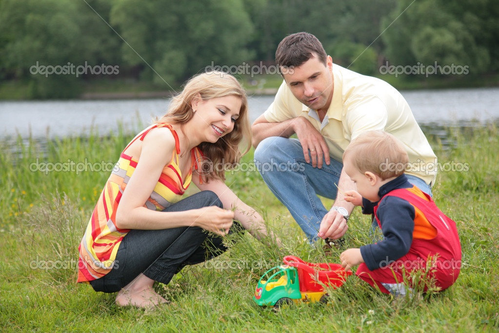 Parents play with child outdoor