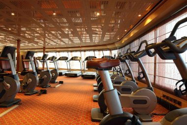 Large gym hall with treadmills and exercise bicycle in cruise sh