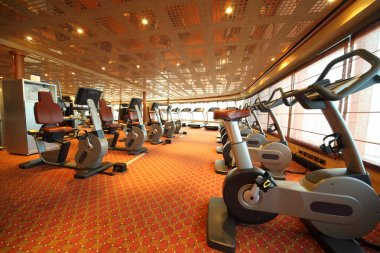 Large gym hall with exercise bicycle in cruise ship general view