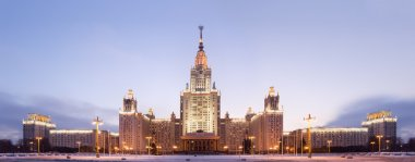 Moscow State University. Front facade view. Panorama. Evening tw