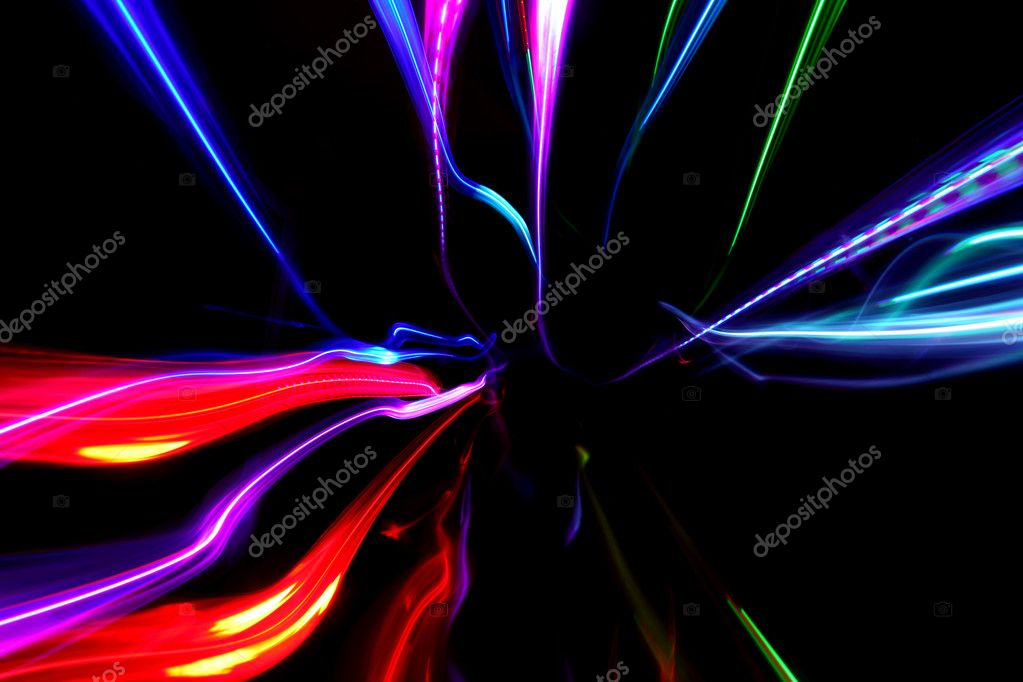 Abstract background with multicolored motion blured lines on black