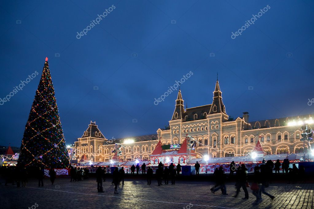 Skating-rink on red square in moscow at night. Big New Year tree