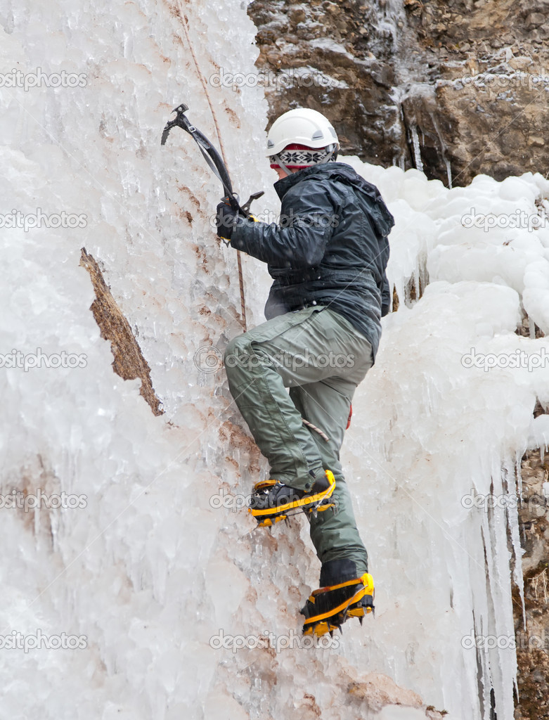 Man with ice axes and crampons