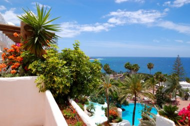 View from balcony on recreation area with swimming pools and bea