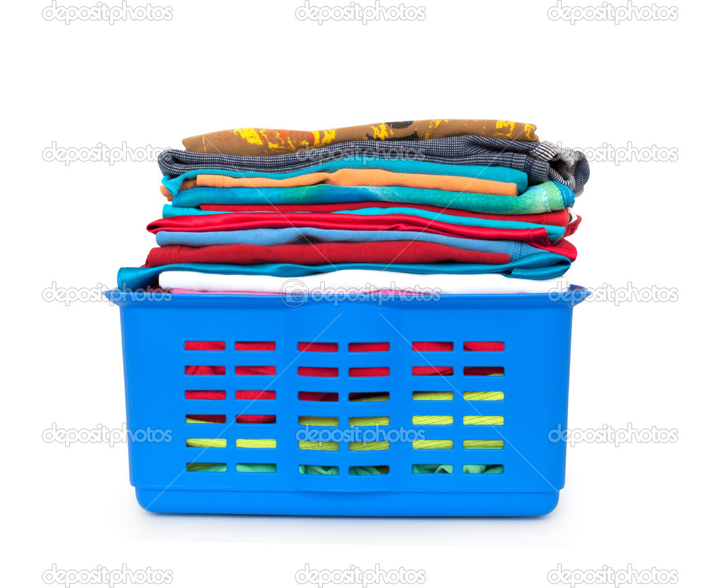 laundry basket with folded clothes � stock photo