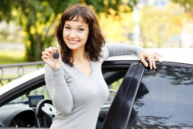 Pretty asian girl showing the car key