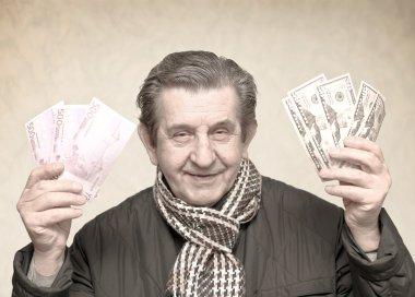 Elderly happy man with pack of money