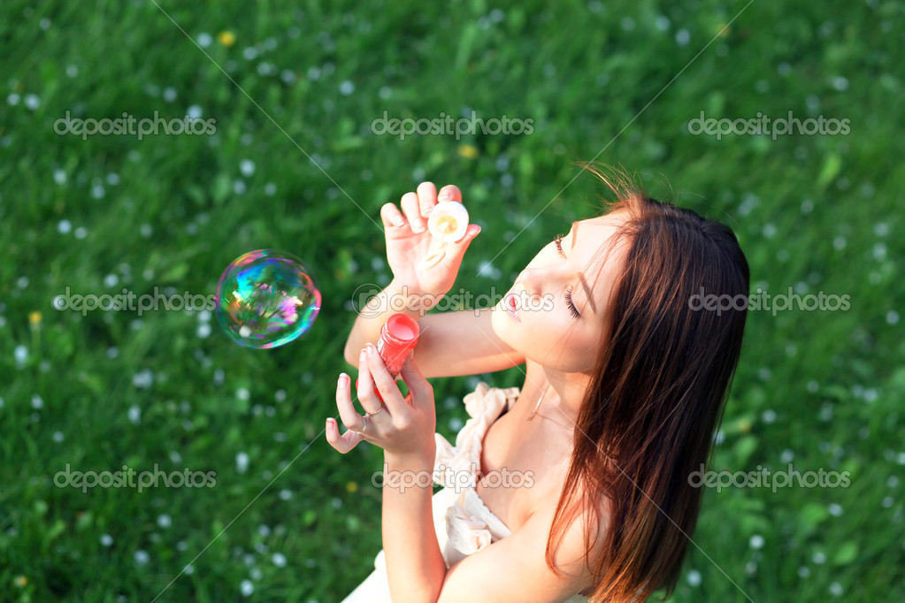 Girl Blowing Bubbles In Garden Picture