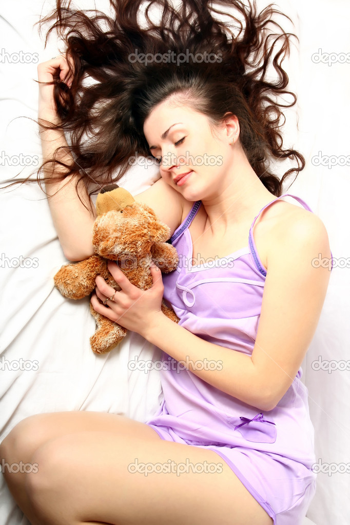 Beautiful young woman in the morning in bed  Photo by InnaSidorova