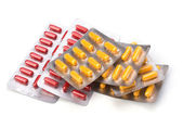 Photo Medical capsules isolated on white