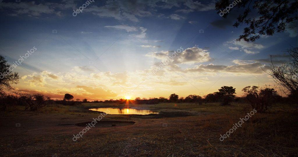 African Sunset over waterhole
