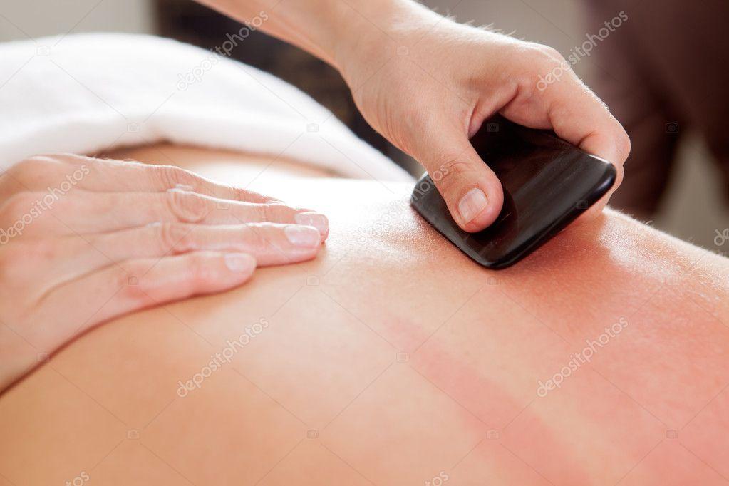 Gua-Sha Acupuncture Treatment on Back