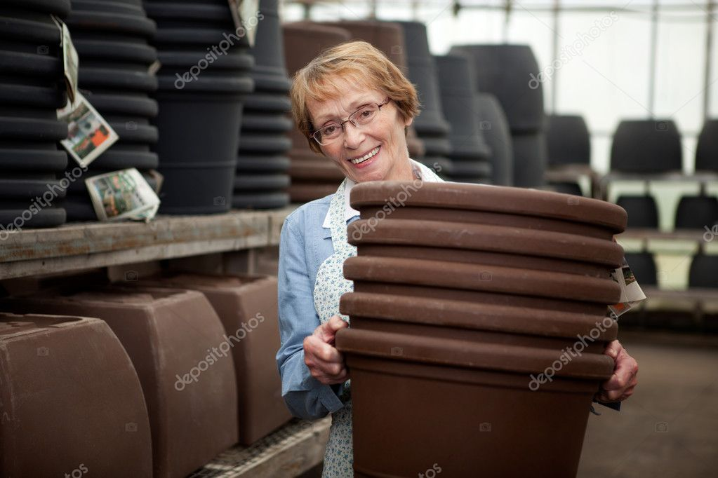 Senior With Plant Pots
