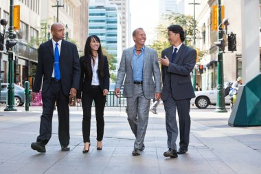 Business walking together on street