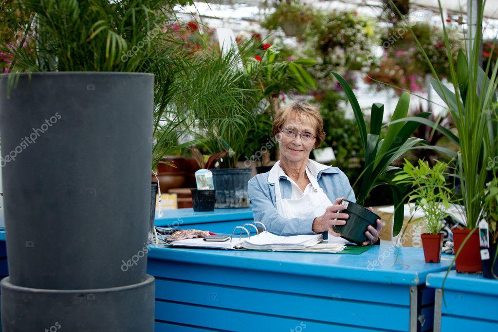Senior Worker in Garden Center