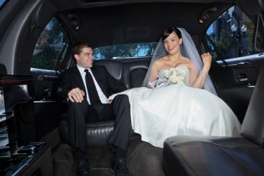 Happy couple in limousine