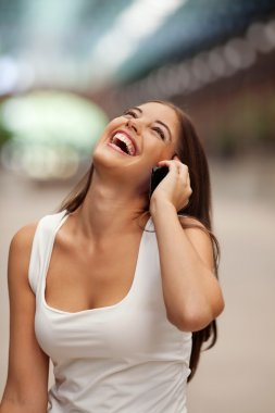 Cheerful Woman Talking on Cell Phone
