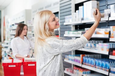 Woman Buying Medicine in Pharmacy