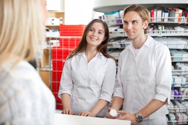 Pharmacists with Customer in Store