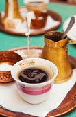 Strong arabic coffee served in a traditional way