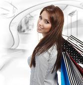 Fotografie Beautiful shopping woman at a draw mall