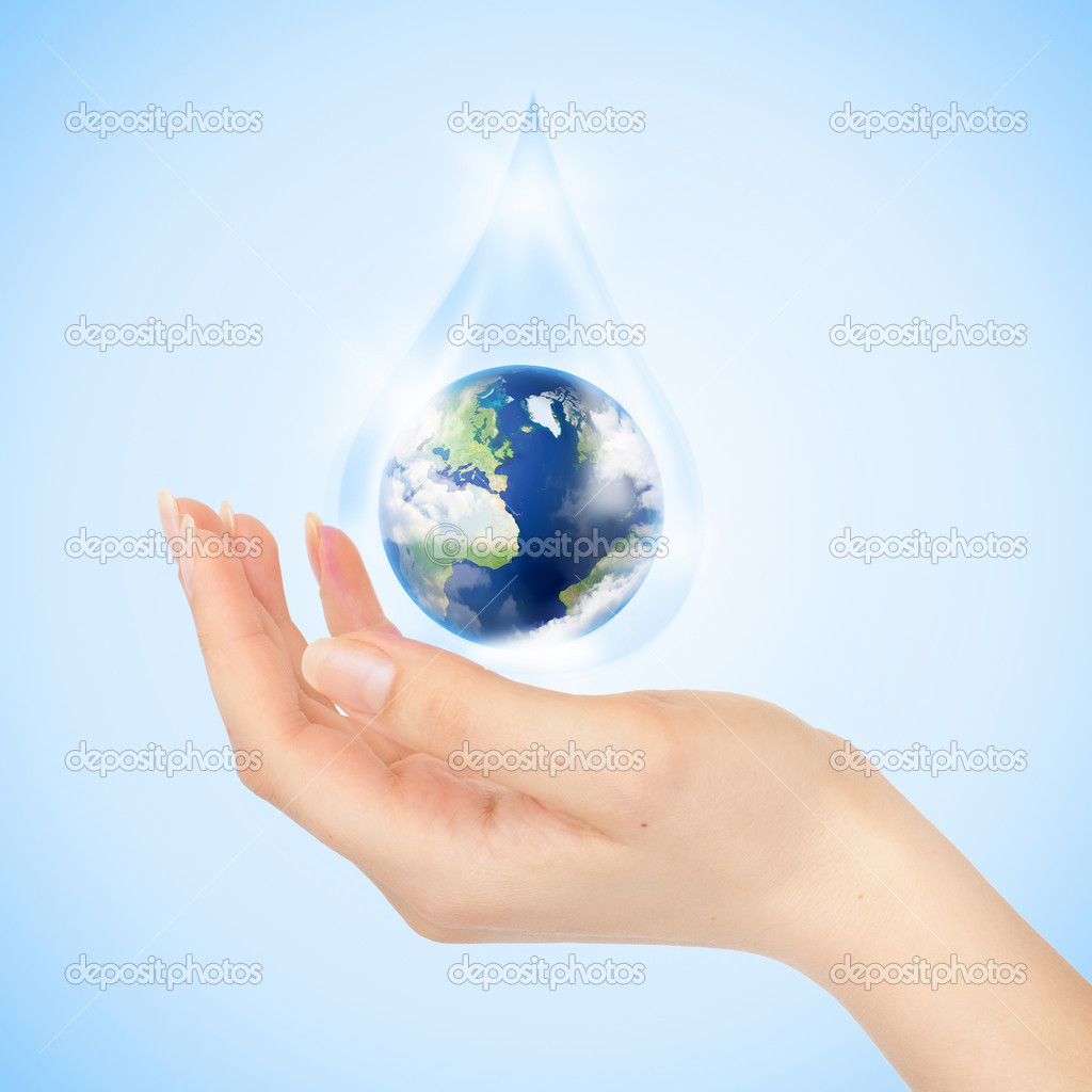 Drop of water with Earth inside and hand