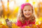 Fotografie Happy girl in autumn park