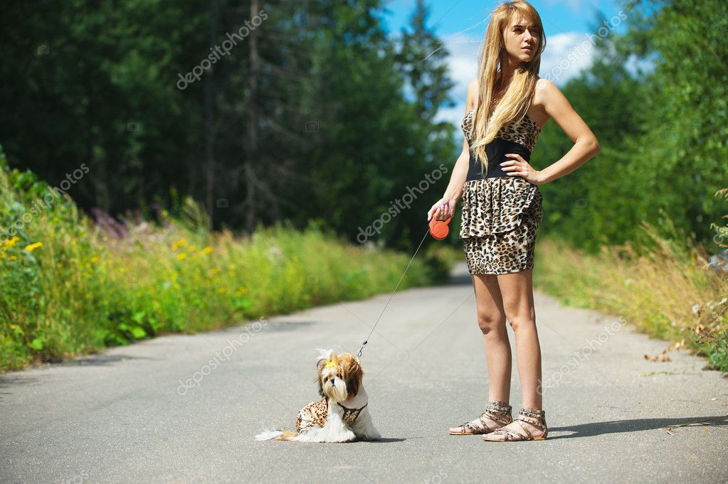 Beautiful woman with dog leash