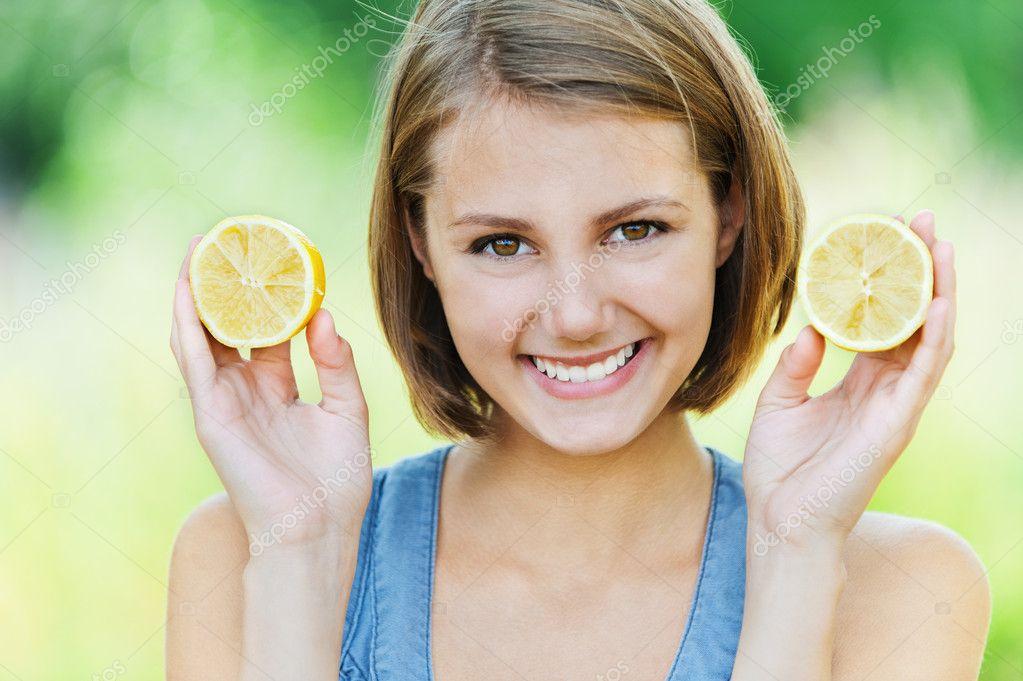 Attractive woman half lemon