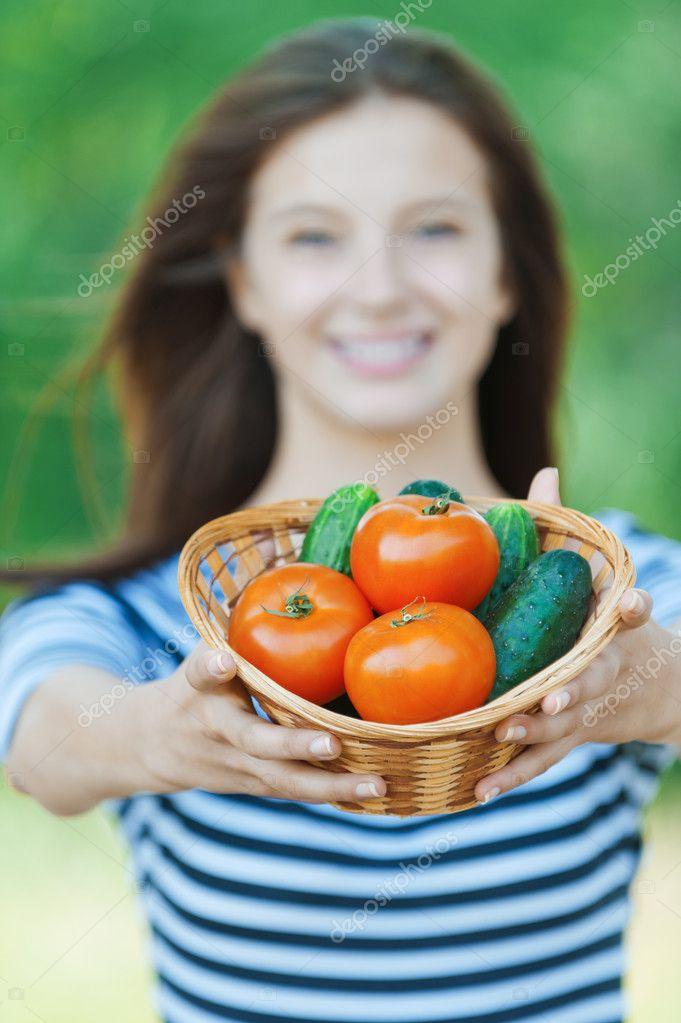 Beautiful woman basket vegetables