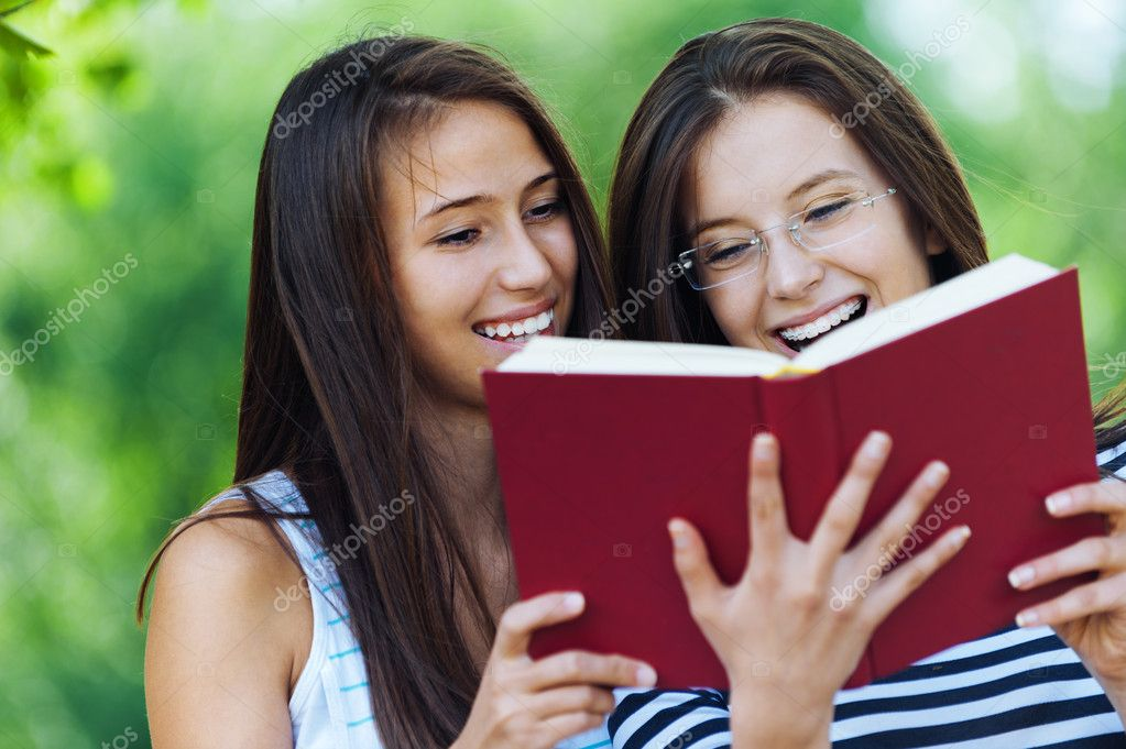 Two women read red book