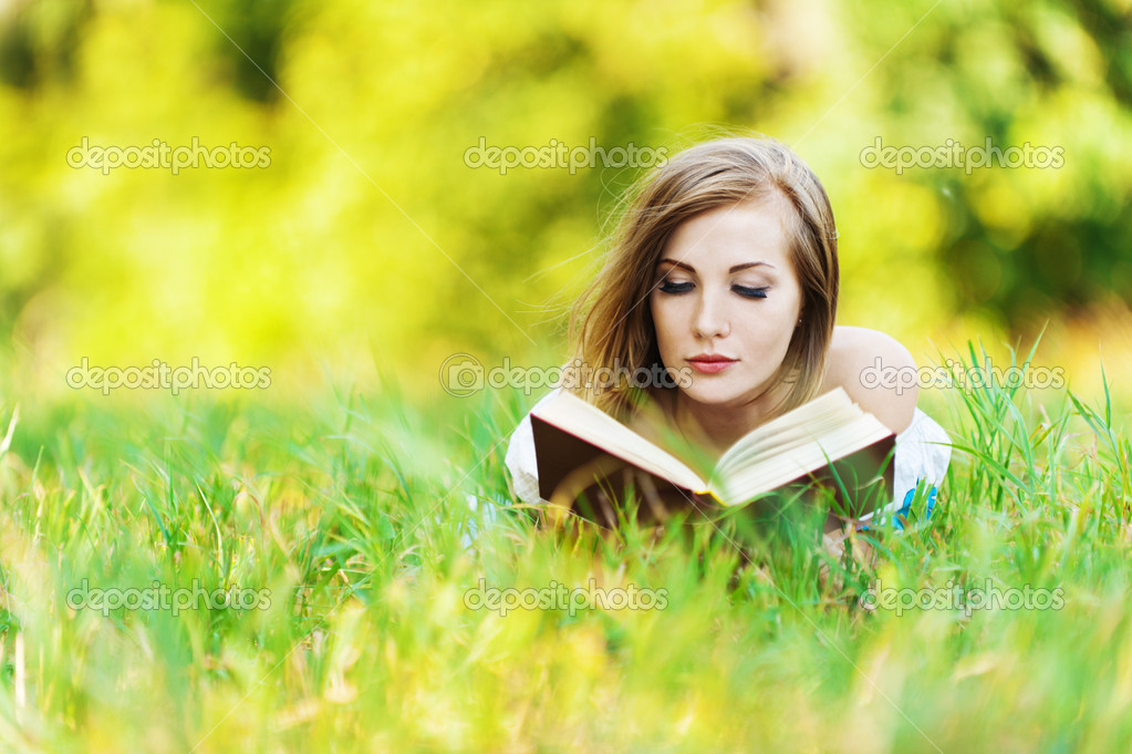 Woman grass reading book