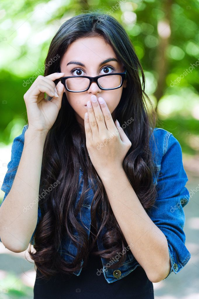 Young girl glasses surprised