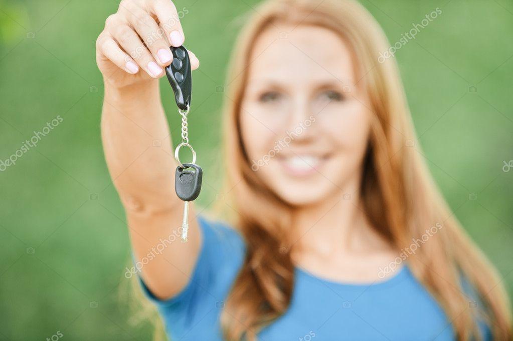Portrait cute young woman car keys