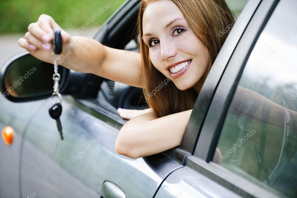 Portrait young attractive woman sitting salon automobile hand ke