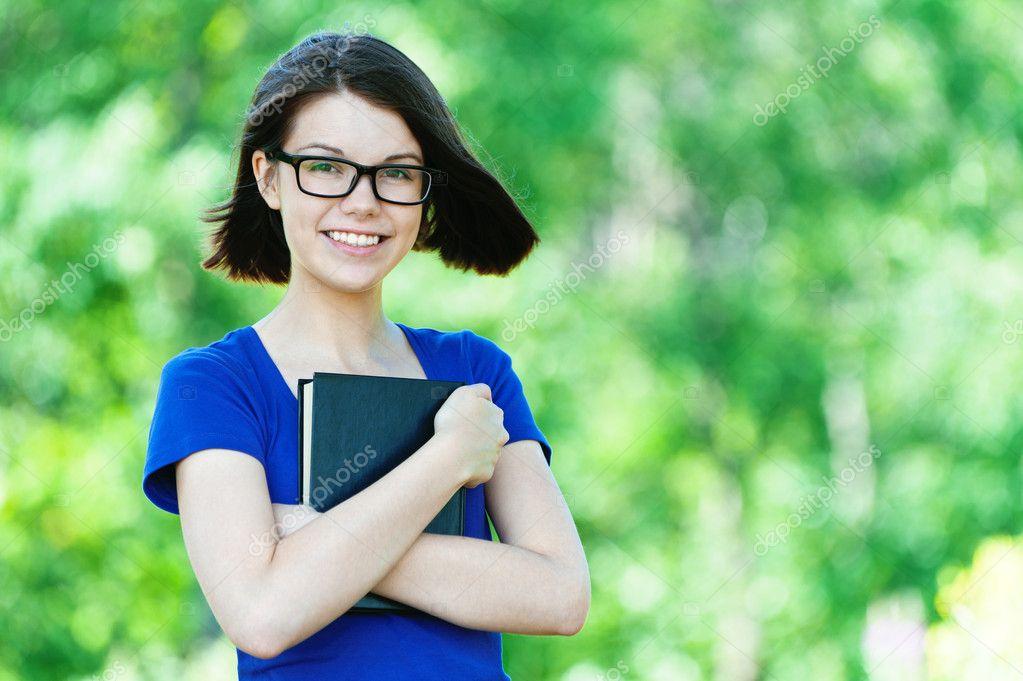 Portrait beautiful student glasses book