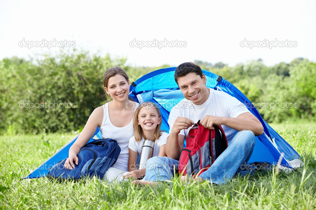 Family with a child in a tent