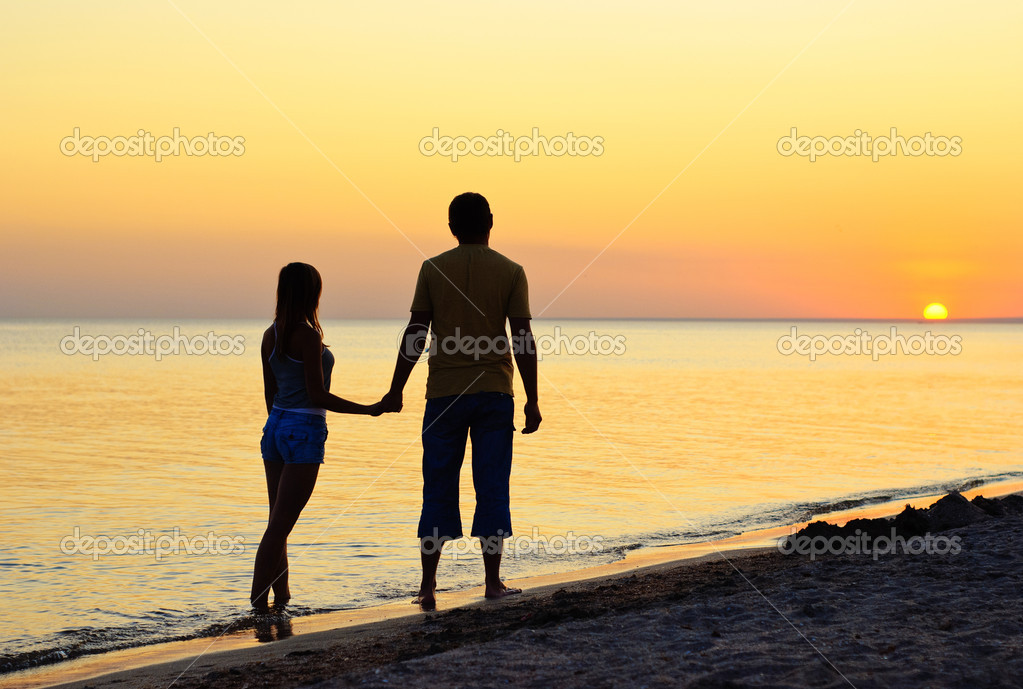 Couple silhouette on the beach