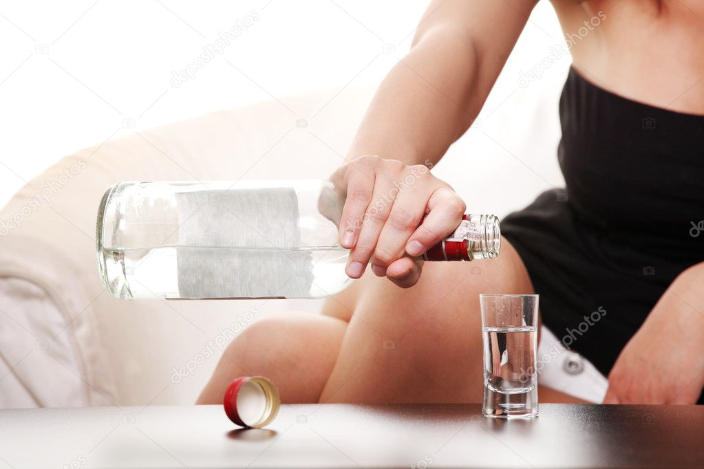 Woman in depression, drinking alcohol (vodka)