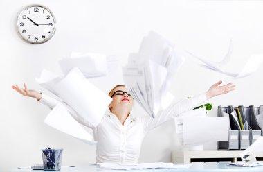 Businesswoman throwing files.
