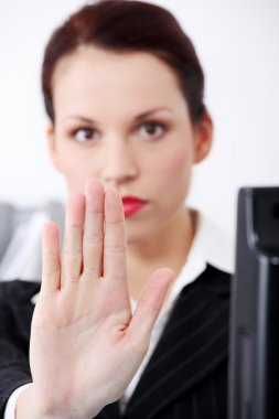 Closeup on woman hand gesturing stop.