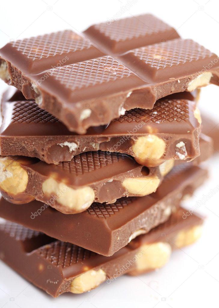 https://static7.depositphotos.com/1003591/698/i/950/depositphotos_6986810-stock-photo-pieces-of-milk-chocolate-with.jpg