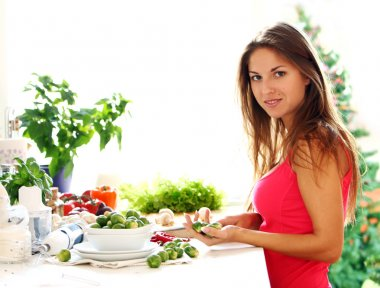 Young woman cooking healthly food