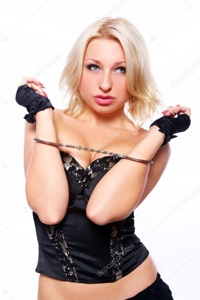 Sexy blonde in handcuffs