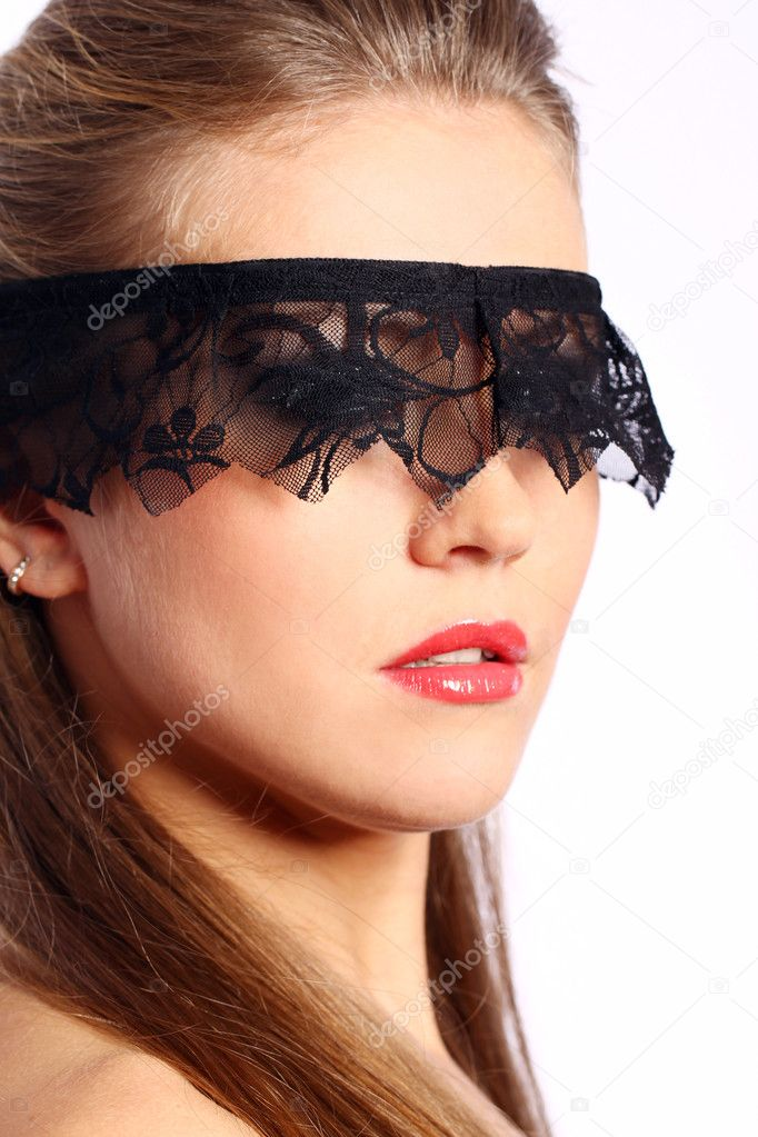 Woman with black lace mask over her face