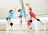 Photo Girls playing volleyball indoor game