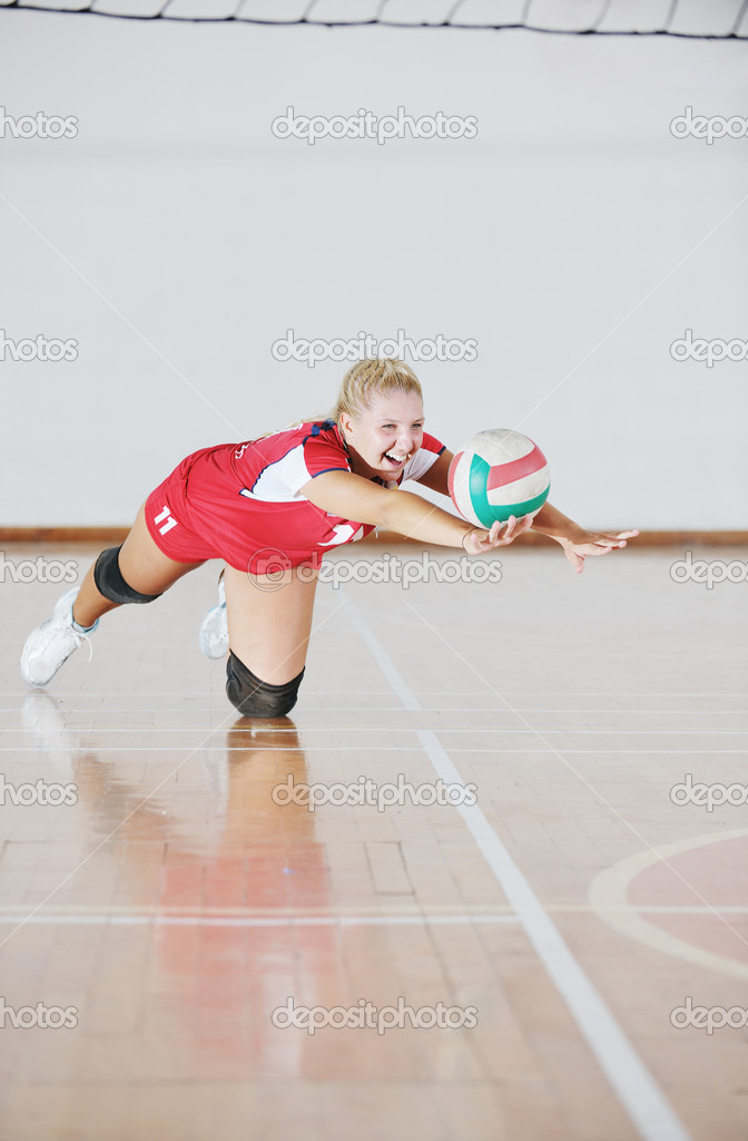 Girl playing volleyball indoor game