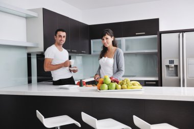 Young couple have fun in modern kitchen
