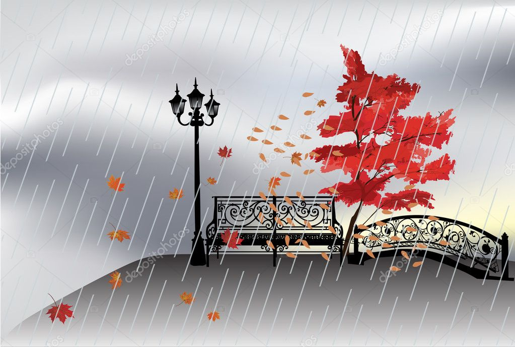 Bench and autumn tree under rain